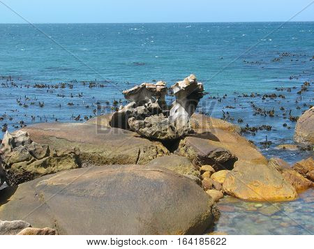 Huge Boulders In Fore Ground, With Sea In Back Ground 12ccv