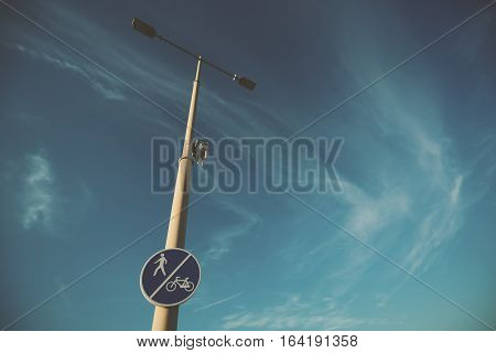 Wide angle shot of street pole with blue road sign