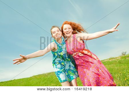 Mother and daughter Having Fun under blue sky
