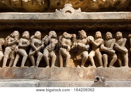 Statue of male female in myriad moods sculpted on wall panel of Lakshman Temple Khajuraho Madhya Pradesh India Asia
