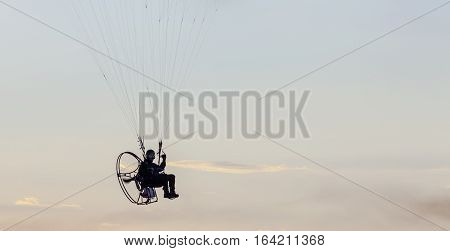 BALTIC SEA, SWEDEN ON JULY 25. View of a powered paraglider or paramotor above the sea on July 25, 2013 by the Baltic Sea, Sweden. Unidentified person in the object. Editorial use.