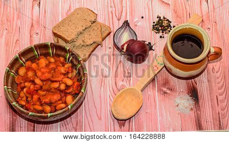 Romanian Traditional Food, Beans With Smoked Pork (fasole Cu Ciolan), Red Onion, Wooden Spoon, Bread