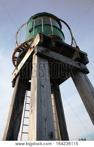 Whitby harbour west cliff pier green beacon wooden structure for guiding boats