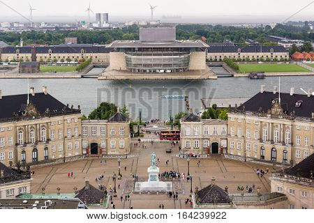 Skyline of the Copenhagen Opera House and Amalienborg, Denmark, July 13, 2016, Opera house is designed by Henning Larsen in 2014. The palace is the home of the Danish Royal family.