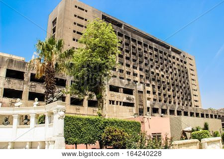 CAIRO EGYPT-MAY 4 2015. The building used by the National Democratic Party of the ousted president Mubarak remains burnt and abandoned serving as a reminder of the 2011 Egypt Revolution Cairo.