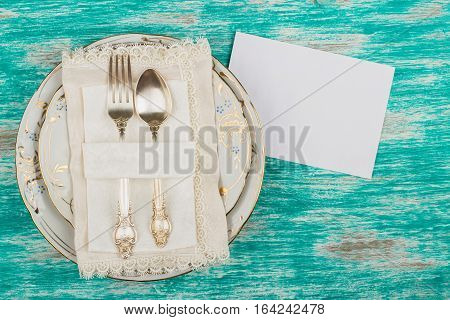 Tableware And Silverware With An Invitations Card