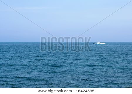 White ship on blue sea horizon, shot in Crimea