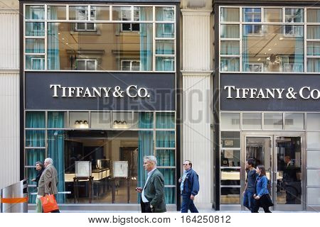 Vienna Austria - 9-22-2016: Shoppers walking in front of a Tiffany and Co. store in Vienna Austria