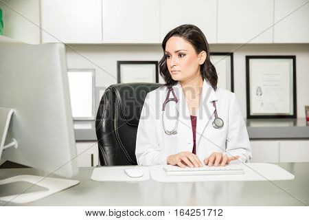 Female Doctor Working In Her Office