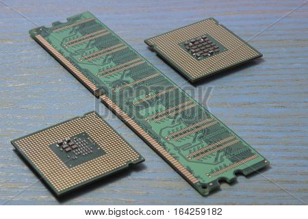computer processor and RAM on wooden background