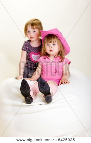 Two toddler girls on the beanbag