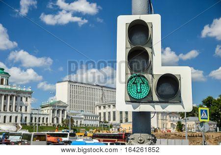 Traffic lights with straight arrow on avenue