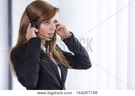 Call center operator having a conversation with a client