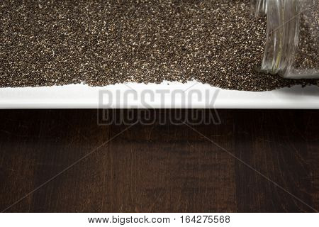 Chia Seeds Spilling Out Of Container, Copy Space