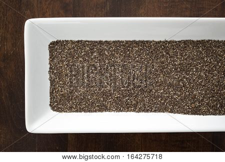 Chia Seeds On White Tray On Wood Table
