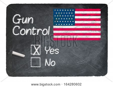 Gun Control voting choice message written on a chalky natural slate blackboard with yes  checkbox filled and chalk
