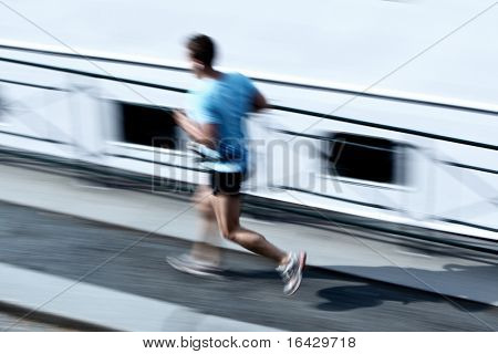 Runner (panning technique used -> motion blurred image)