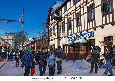 SLOVAKIA STARY SMOKOVEC - JANUARY 06 2015: Rush hour at railway station Stary Smokovec in High Tatras mountains. Is a popular resort for skiing and hiking. And junction of the Tatra Electric Railway