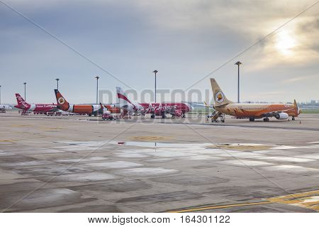BANGKOK THAILAND - AUGUST 20 : thai air asia and nok air low cost airline plane parking at Donmuang airport on august 20 2014 in bangkok thailand