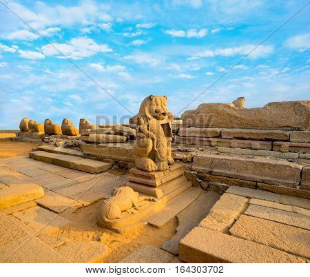 beautiful ancient sculpture of lion monolithic famous Shore Temple in Mahabalipuram Tamil Nadu India