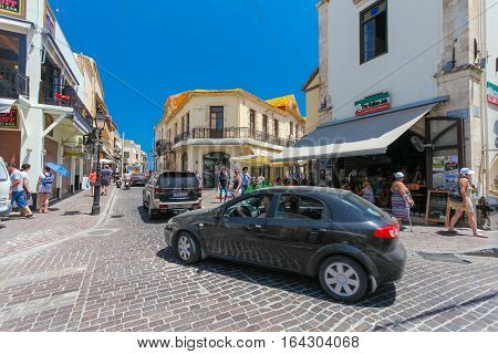 Rethymnon, Island Crete, Greece- July 1 2016: Cars and tourists on the street of the old town's part of city Rethymnon
