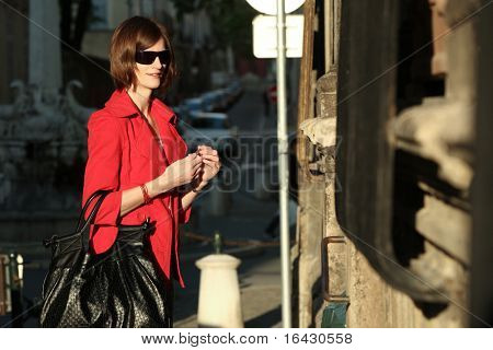 young french woman coming to her house from work