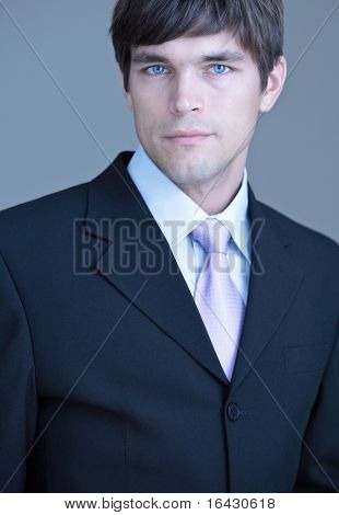 Close-up portrait of a young handsome confident businessman/lawyer