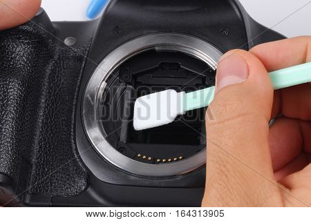 Digital-SLR Sensor cleaning and MaintenancePhotographer hand cleaning sensor of camera by using sensor swab and vacuum pumpcleaning dirty camera sensor (CCD or Cmos)