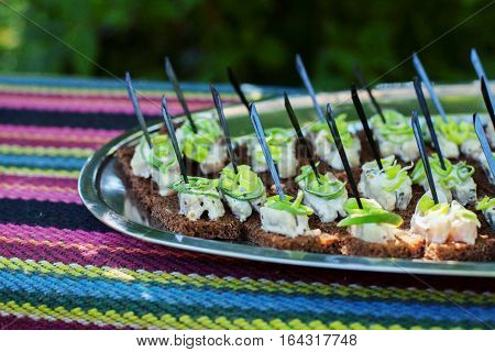 Appetizer of herring and leek. The concept of food and catering.