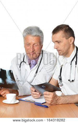 Portrait of a male doctors with x-rays , discuss problem