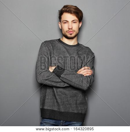 life style, emotional and people concept: Portrait of sexy man over grey background