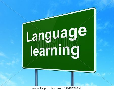 Learning concept: Language Learning on green road highway sign, clear blue sky background, 3D rendering