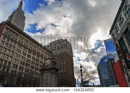 Watch tower in herald square in manhattan and empire state building.