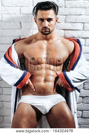 Handsome Muscular Macho In Bathrobe
