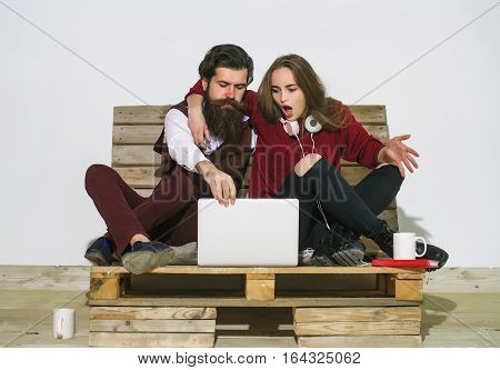 Young Couple Surfing Internet Together