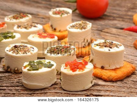 Feta cheese appetizer with spices on wooden table