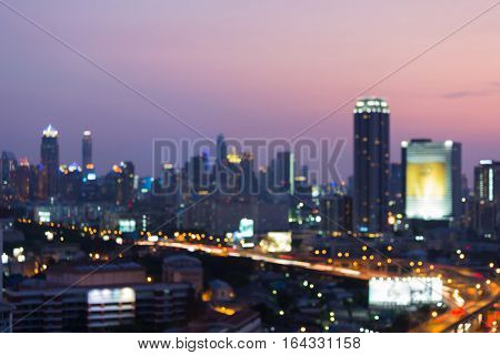 Blurred lights office building and highway night view abstract background