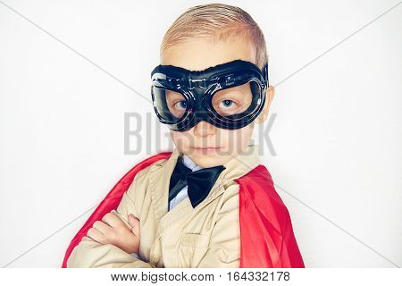 Little Kid In Aviator Glasses And Cloak