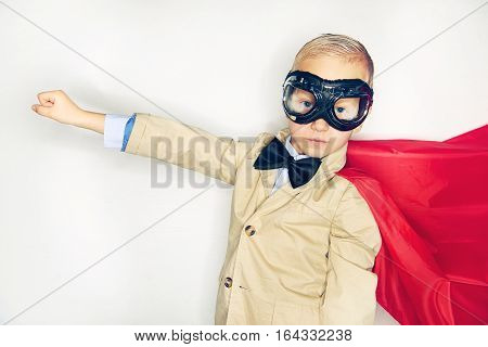 Little Funny Boy In Hero Costume Posing