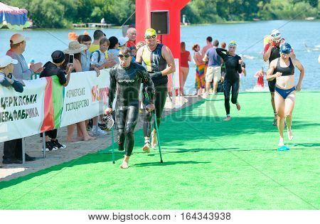 Triathlon Cup of Ukraine and Cup of Bila Tserkva. July 24 2016 in Bila Tserkva Ukraine. Paralympic athlete disabled man on distance