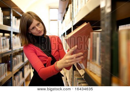 pretty female college student in a llibrary
