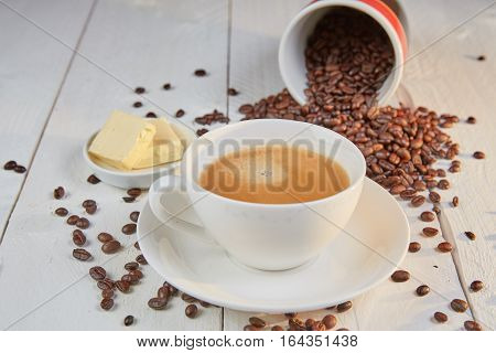 Bulletproof Coffee In White Cup With Butter