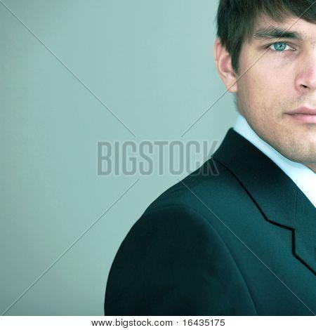 Portrait of a young handsome confident businessman (color toned image)
