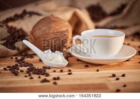 Bulletproof Coffee With Coconut Butter On Spoon
