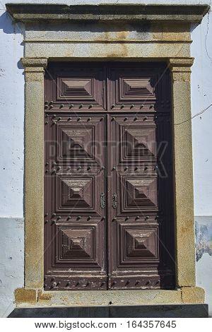 A antique wooden door in european street.