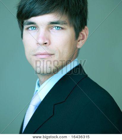 Close-up portrait of a young handsome confident businessman
