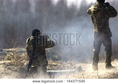 Military soldiers at tactical exercises with guns