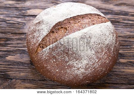 whole fresh loaf of round rye bread with a crispy crust