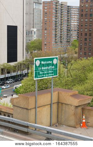 NEW YORK - APRIL 29 2016: Welcome to Manhattan sign at the end of the brooklyn bridge