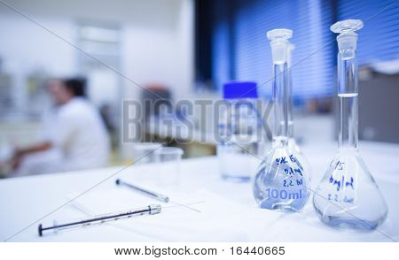 chemistry research center lab (shallow DOF; focus on the glassware in the foreground)